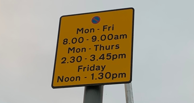 parking sign at Broadway shops side